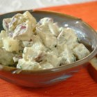 Dill Potato Salad - New potatoes are dressed with a tangy dressing of sour cream, dill weed, parsley and Dijon mustard.  Sprinkle with sliced green onions before serving, if desired.