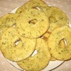 Salt and Garlic Bagel Chips - Don't know what to do with those stale bagels? Make them into crispy, salty snacks! These bagel chips are heavy on the garlic and the real Parmesan cheese and Italian herbs give them a hearty flavor for satisfying snacking.