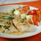 Dijon-Tarragon Cream Chicken - Chicken breasts bathed in a delicate mustard tarragon sauce. A quick and simple recipe that you can serve on a weeknight but tastes like a French chef came to your house!