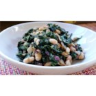 Greens with Cannellini Beans and Pancetta - This is a forgiving recipe, and a great way to get your greens! Kale is cooked with onions and garlic, a small amount of pancetta or bacon, and cannellini beans to make a great main dish for two or side dish for 4 or more.
