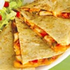 Chicken Quesadillas - Zesty chicken and cooked peppers are a tasty delight when mixed with cheese and stuffed in a tortilla to create chicken quesadillas.