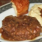 "Smothered Hamburger Steak - Ground beef ""steaks"" are smothered and simmered in mushroom gravy for a classic Southern supper."