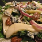 Pear and Blue Cheese Salad - A sweet-tangy brown sugar-maple syrup dressing gets its zip from apple cider vinegar and performs as the perfect partner for a leafy green salad tossed with pears and candied pecans.