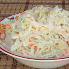 Hawaiian Cole Slaw - Coleslaw mix, pineapple, and onion are mixed in a creamy dressing in this sweet and tangy Hawaiian cole slaw recipe that is great will pulled pork.