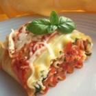 Lasagna Roll Ups - Mozzarella, Parmesan, and ricotta cheese are mixed with tofu and spinach to make a substantial filling for this lasagna variation.