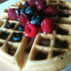 Michele's Cinnamon Roll Waffles - Whole-grain waffles, served with a cinnamon drizzle and an icing drizzle, are like cinnamon rolls in waffle form.