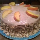Peaches and Cream Cake - Four layers of French vanilla flavored cake assembled with canned peaches and a cream cheese filling.