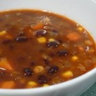 Black Bean Vegetable Soup - Half of the black beans in this spicy soup are pureed with tomatoes, the other half are simmered with carrots, onion and kernels of corn.