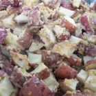 Parmesan Potatoes - Potatoes are peeled and cubed, coated with a mixture of Parmesan and flour, and baked with butter.