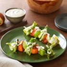 Harvest Salad-on-a-Stick - Skewers of baked sweet potato slices, lettuce wedges, and apple chunks are drizzled with creamy Hidden Valley(R) Original Ranch(R) Dressing.