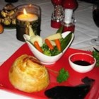 Mini Beef Wellingtons with Red Wine Sauce - This recipe was given to me by a dear friend.  It's perfect for a special occasion, and is as good as you'll get from any restaurant.  The filets are topped with a mixture of liver pate (pate de foie gras) and mushrooms and wrapped with puff pastry and served with a red wine sauce!