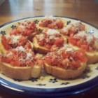 Nikol's Garlic Bruschetta - This bruschetta features toasted sourdough, topped with garlic herb cheese spread and lightly marinated tomatoes.