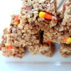 Crispy Rice Candy Corn Treats - Candy corn and chocolate chips are a fun Halloween addition to the classic crispy rice and marshmallow treats. Trick or treat!