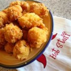 Vicki's Hush Puppies - This is a simple, no-fuss recipe for that favorite, fried cornmeal concoction. Eggs are combined with sugar, onion, flour and cornmeal, and then deep fried.