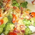Broccoli and Tomato Bake - Flavorful, fresh vegetables are baked together with olives, diced tomatoes, and goat cheese for this colorful and cozy side dish.