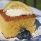 Lemon Poke Cake II - This is a moist lemony cake. It is called a poke cake because you poke holes in it to absorb the glaze.  If you want, you can serve this with vanilla ice cream or whipped topping.