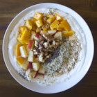 Morning Fruit Bowl - This morning fruit bowl provides a healthy meal to start the day, a parfait including Greek yogurt, fruit, oats, chia seeds, hemp seeds, and walnuts.