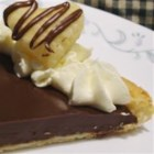 Rich Chocolate Tart - Don't let fears of pastry failure keep you from making a homemade holiday sweet. This rich chocolate tart is a ridiculously easy and scrumptious dessert made with a puff pastry crust.