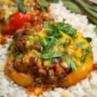 Stuffed Mexican Peppers - Mexican-inspired ground beef and rice stuffing fills red or green bell peppers for a family-pleasing meal.