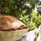 Mile-High Apple Pie - This luscious apple pie stands tall among its competitors. A mixture of potato starch, sugar, cinnamon, and freshly ground nutmeg seasons the apples and keeps their juices stabilized.