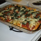 Rita's Spinach Casserole - This is a quick and delicious way to get kids to eat spinach! Ground beef and tomato sauce are layered in a casserole with spinach and mozzarella cheese.