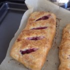 Black Walnut and Cherry Strudel - Black walnut and cherry strudel topped with a simple glaze is worth the time it takes to prepare. Slice into small pieces to serve.