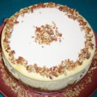 Carrot Cake Cheesecake - Carrot cake cheesecake, a cake with 1 layer carrot cake and 1 layer cheesecake, is topped with almond frosting for a festive and decadent dessert.