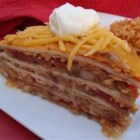 Mexican Casserole - Small dinner pie made with salsa, tortillas, refried beans, cheese, and onions.