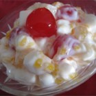 Fruit Salad - Sour cream binds this salad of pineapple chunks, maraschino cherries, and mandarin orange slices with miniature marshmallows.  Serve with a Thanksgiving dinner or as a dessert.