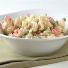 Macaroni Salad - I picked up this recipe from Germany, it is very simple and tasty.  For a different taste, omit the gherkins and add 1/4 cup of chopped ham. The basic recipe is also delicious with boiled new potatoes instead of pasta.
