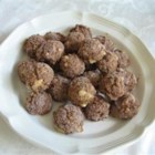 High Protein Peanut Butter Balls - Instead of reaching for a processed boxful of ingredients you can't even pronounce, you can create this healthy, high-protein snack made with peanut butter, banana, protein powder, and flax seed.