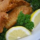 Beer Batter Fish Made Great - Fried fish filets in a spicy beer batter with lots of paprika and garlic powder.