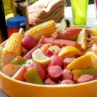 King Crab and Shrimp Boil - King crab and shrimp are boiled with sausage, corn, and seafood seasoning in this quick and easy shrimp boil recipe.