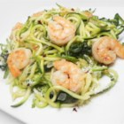Shrimp Florentine with Zoodles - Shrimp and spinach are cooked in a buttery sauce with zoodles (zucchini noodles) in this gluten-free, grain-free version of an Italian classic.