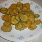 Fried Zucchini - Simple and delicious recipe for tender zucchini with a thin, crispy coating of cornmeal.