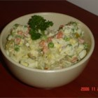 Argentinean Potato Salad - A classic South American potato salad, also known as 'Ensalada Rusa,' that contains chopped green olives and mixed vegetables with a little kick of lemon and ground mustard.