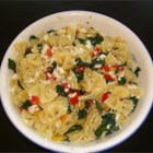 Sweet Pepper Pasta Toss with Kale - Sauteed sweet peppers and kale are tossed with farfalle pasta and sprinkled with a generous amount of crumbled feta cheese. This recipe was inspired by a similar recipe I received in my produce box from Full Circle Farm in Carnation, WA.
