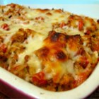 Bruschetta Chicken Bake - A simple yet creative chicken meal mimics the popular Italian appetizer 'bruschetta' for a delicious entree reminiscent of romantic Italian evenings.