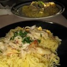 Astoria Crab Pasta - Angel hair pasta is topped with crab and a browned butter sauce in this quick, romantic dish.