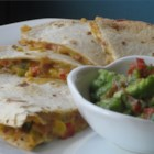 Bean Quesadillas - Veggies, beans, and cheese sandwiched between two tortillas then heated in oil until golden on both sides.
