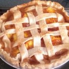 Freezer Peach Pie Filling - Peach filling is prepared ahead of time and frozen inside a pie plate. When ready to bake, simply place it in a crust-filled pie plate of the same size, and bake.