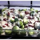 Nana White's Famous Brussels Sprouts - In this hearty recipe Brussels sprouts are baked with bacon, onions, milk, white wine  and savory herbs.  You can make this dish ahead of time and refrigerate it before baking.