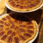 Sweet Potato Pecan Pie - A cinnamon, ginger, and nutmeg spiced sweet potato filling is sprinkled with chopped pecans in this pie which is served with a hazelnut liquer whipped cream topping.