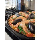 Paella I - A very traditional paella, garnished with chorizo, chicken, peas, squid, mussels, and shrimp. Chorizo is a sausage spiced with garlic and chili powder; remove casing before cooking.  A paella pan is recommended.