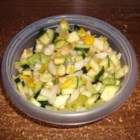 Sweet and Sour Zucchini Salad - Lots of interesting stuff in this marinated zucchini salad. Onion soup mix, white wine vinegar, apple cider vinegar, chopped veggies, sliced zucchini, and time in the fridge to mingle and chill. Six generous servings.