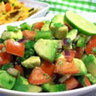 Avocado Salad - Fresh avocados tossed with sweet onion, green pepper, tomato, cilantro and lime juice.