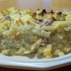 Ultimate Breakfast Casserole - Ham and potato casserole in a creamy sauce. Drizzling butter on top is the key to a delicate golden crust.
