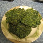 Spinach Pancakes - Simple spices, eggs, flour, and spinach are used to make these spinach cakes pan-fried in a small amount of olive oil until crisped and browned. These make a quick and tasty side dish, and are a great way to add veggies to your meals.