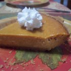Pumpkin Cheese Pie - Only five ingredients are needed for the filling of this tasty cheesecake-like pumpkin pie.
