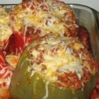 Chorizo Stuffed Bell Peppers - Bell peppers are stuffed with a spicy blend of chorizo, onions, garlic, fresh herbs, Worcestershire, three kinds of cheese, and rice. If you have a taste for spice, you'll love them.